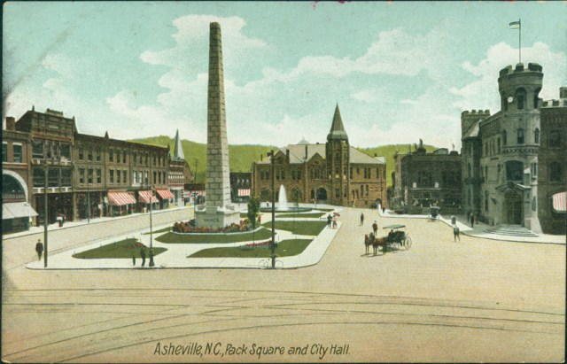 Pack Square, Vance Monument, and City Hall, with streetcar tracks in foreground. Tracks leading toward right ran down South Main Street.
