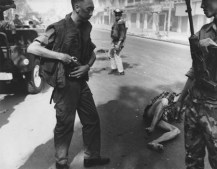 General holstering gun after execution, Saigon,1968 Eddie Adams