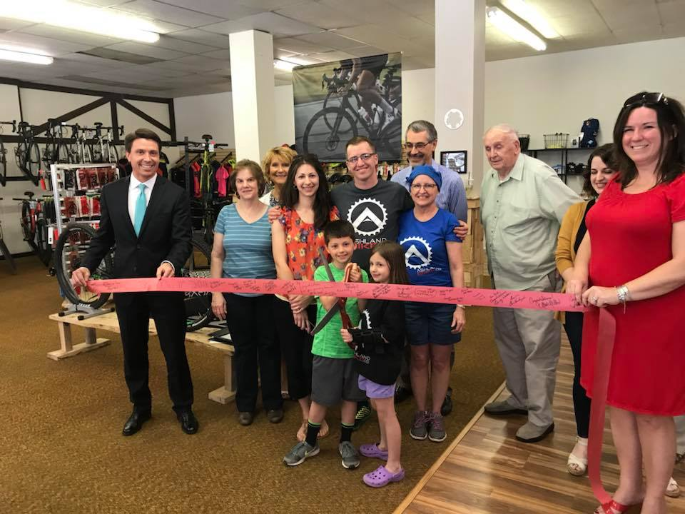 ashland bike company owners cutting the ribbon in their shop