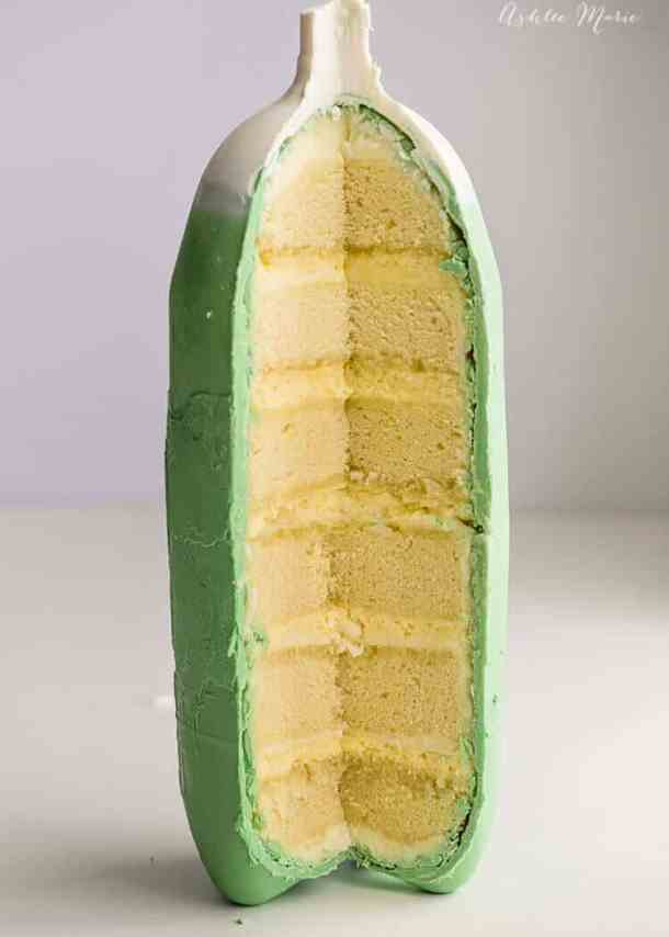 the outside of the soda bottle cake is chocolate and the inside is layers of frosting, cake and mousse - all soda flavored!