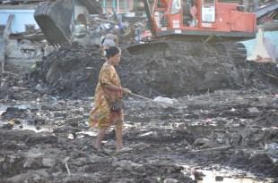 Digging through piles of garbage
