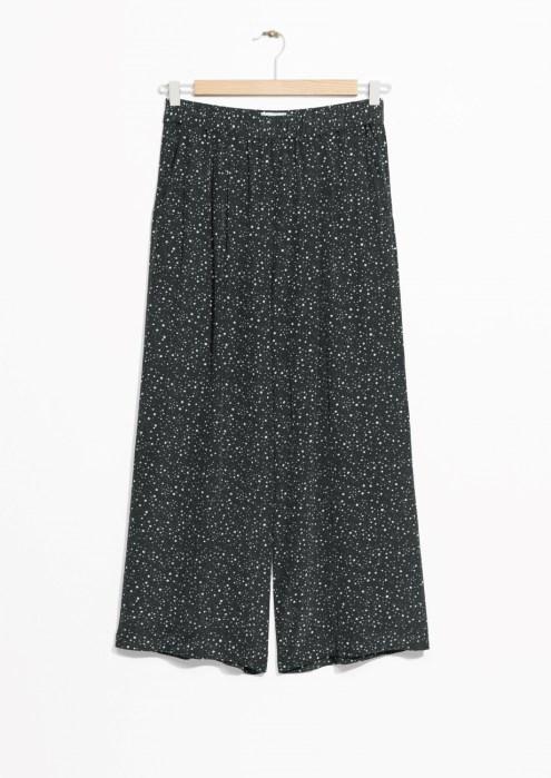 black starry print trousers