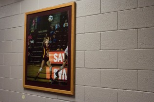 Lining the hall of the Rose Center are pictures of athletes showing off their strength.
