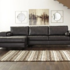Chocolate Brown Leather Sectional Sofa With 2 Storage Ottomans How To Remove Musty Odor From Sofas Ashley Furniture Homestore Large Nokomis Piece Chaise Charcoal Rollover