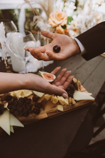 Charcuterie board detail with bride and groom | Reception details at Treehaus Colorado | Elopement at Treehaus, Colorado |  Treehaus Colorado | Colorado elopement | Treehaus elopement | Colorado elopement venue | Colorado mountain elopement venue | Unique elopement venue | Elopement venue in Colorado | Ashley Joyce Photography 2020