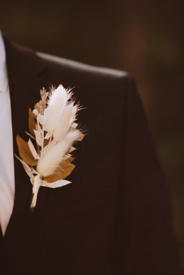 Boutonniere detail | Groom's boutonniere | Groom standing in the forest in Colorado | Groom attire | Wedding portraits | Elopement portraits | Bride and groom elopement photos | Elopement wedding photos in Colorado | Colorado wedding photos | Colorado elopement photos | Elopement at Treehaus, Colorado | Treehaus Colorado | Colorado elopement | Treehaus elopement | Colorado elopement venue | Colorado mountain elopement venue | Unique elopement venue | Elopement venue in Colorado | Ashley Joyce Photography 2020