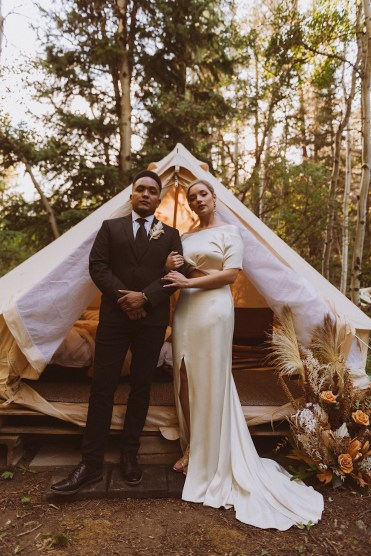 Bride and groom standing in front of wedding tent at Treehaus Colorado | Wedding portraits | Elopement portraits | Bride and groom elopement photos | Elopement wedding photos in Colorado | Colorado wedding photos | Colorado elopement photos | Elopement at Treehaus, Colorado |  Treehaus Colorado | Colorado elopement | Treehaus elopement | Colorado elopement venue | Colorado mountain elopement venue | Unique elopement venue | Elopement venue in Colorado | Ashley Joyce Photography 2020