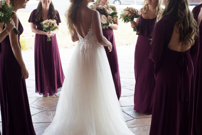 Bridal party photos don't have to be posed to be perfect. Capturing the candid moments makes all the difference. Sticking to wedding photography timelines means you won't miss a moment.