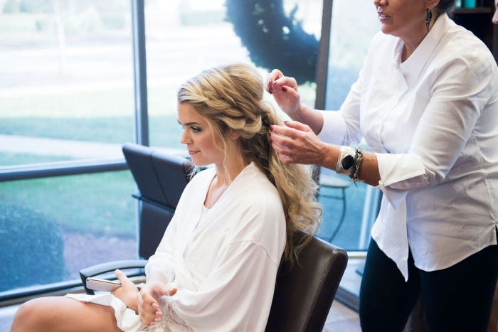 Hair and makeup services can impact wedding photography timelines, so we recommend scheduling time buffers so you can fit in all the portraits you want to capture.