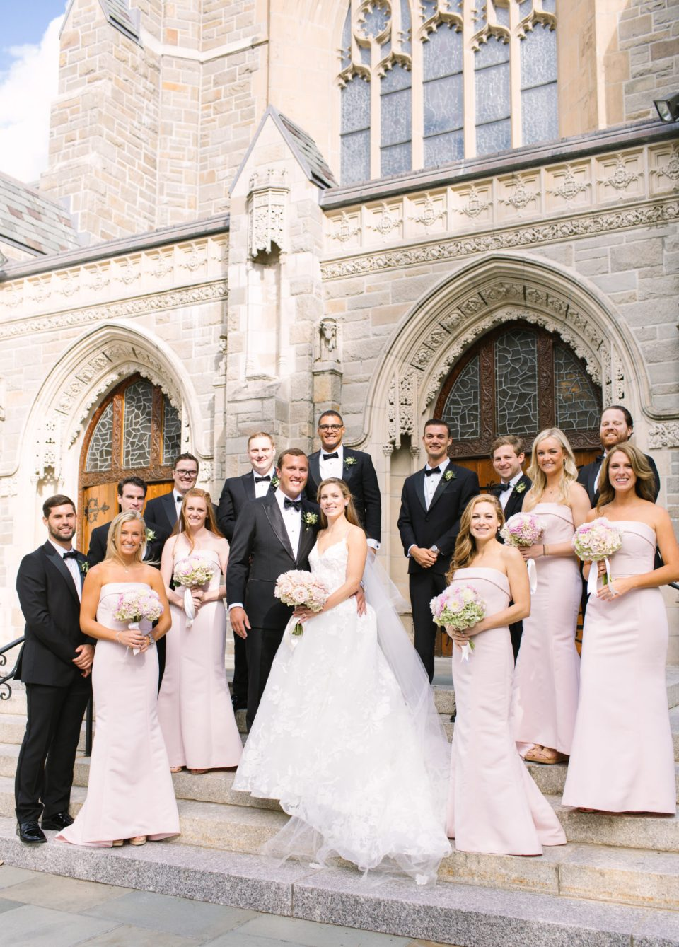 bridal party outside church photographed by Ashley Mac Photographs