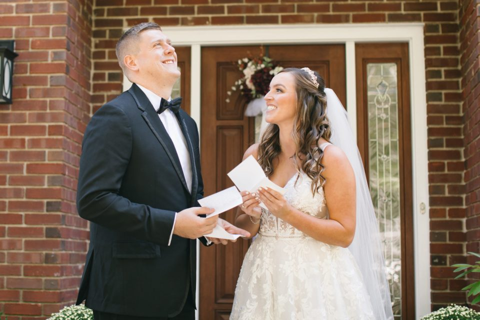 bride and groom exchange letters on wedding day with Ashley Mac Photographs