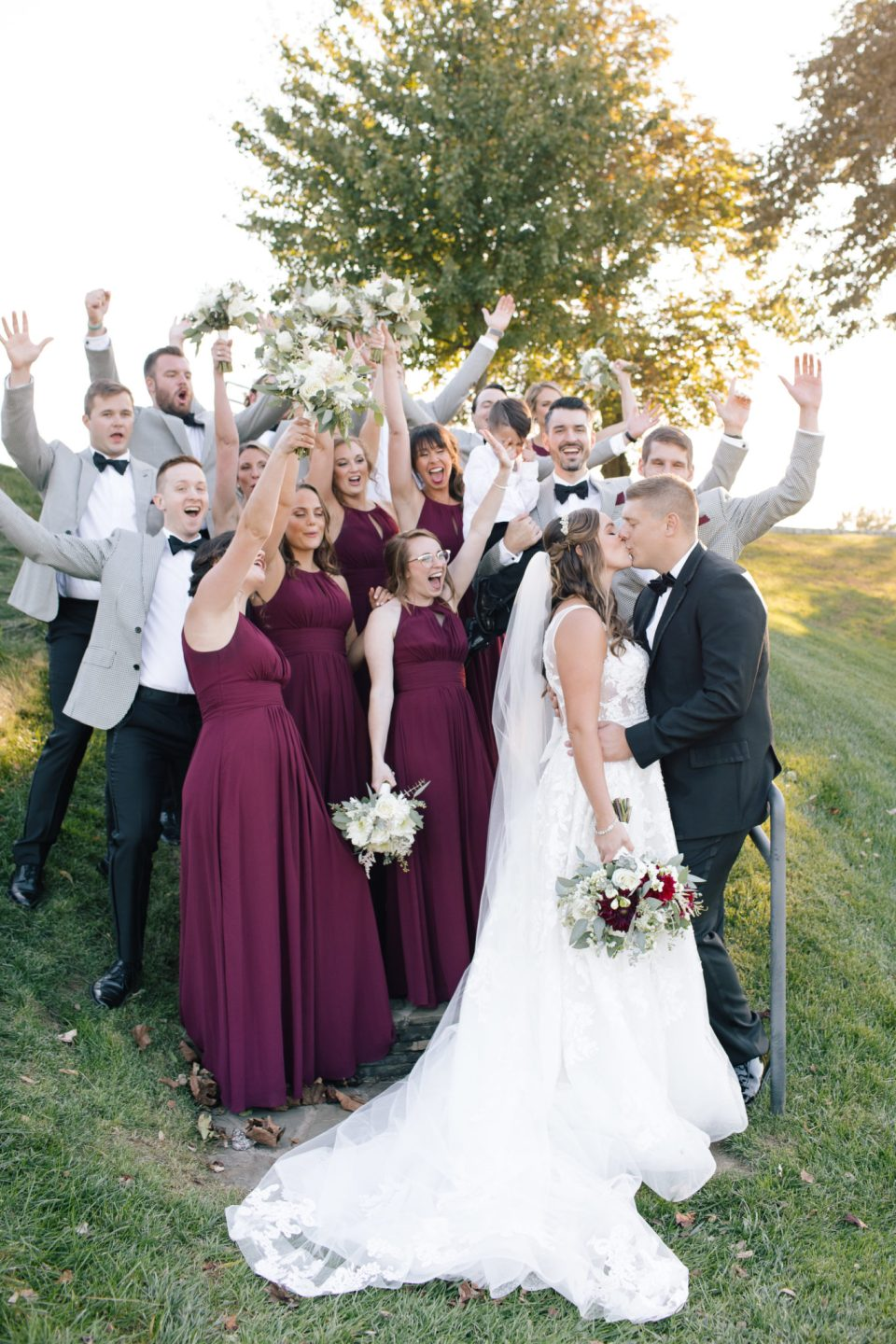 wedding party in burgundy and black photographed by Ashley Mac Photographs