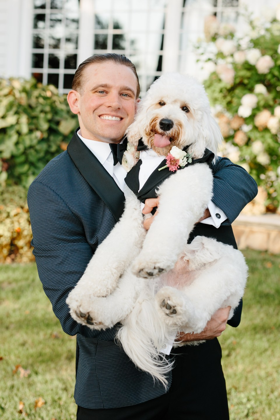 groom with dog photographed by Ashley Mac Photographs in New Jersey