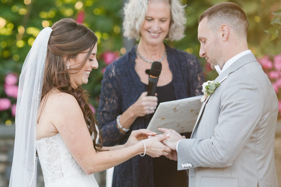 bride and groom exchange vows with Ashley Mac Photographs