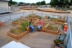 Master Gardener Kathy Williams and Cooperative Extension Community Based Instructor Jenny Digesti at the Grow Yourself Healthy school garden at Libby Booth. Photo by Master Gardener Bill Kositzky.