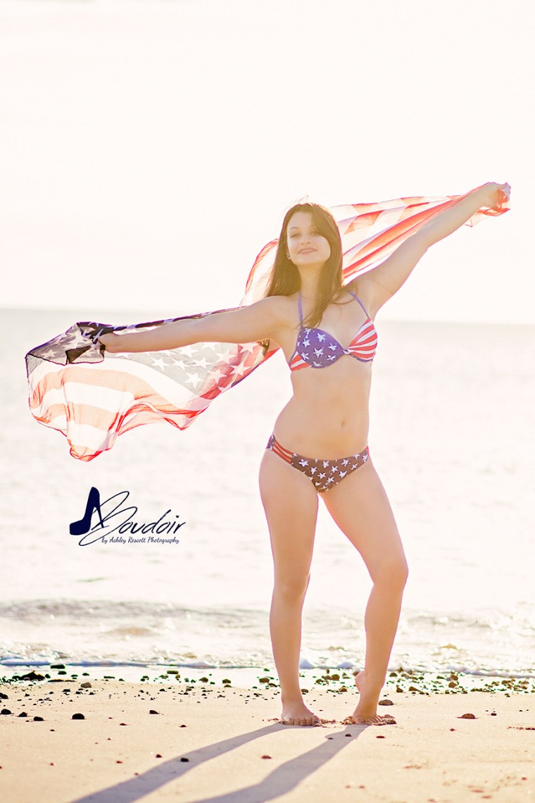 girl on beach with american flag