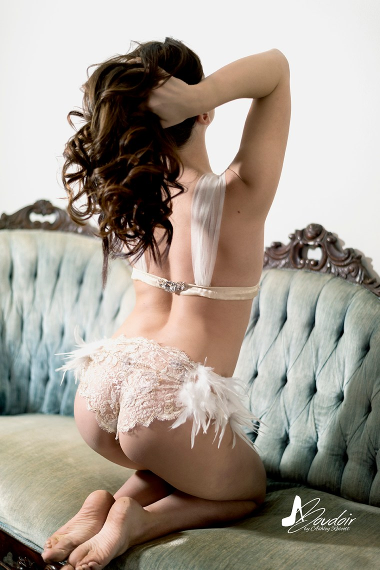 woman in lace and feather bra and panty set