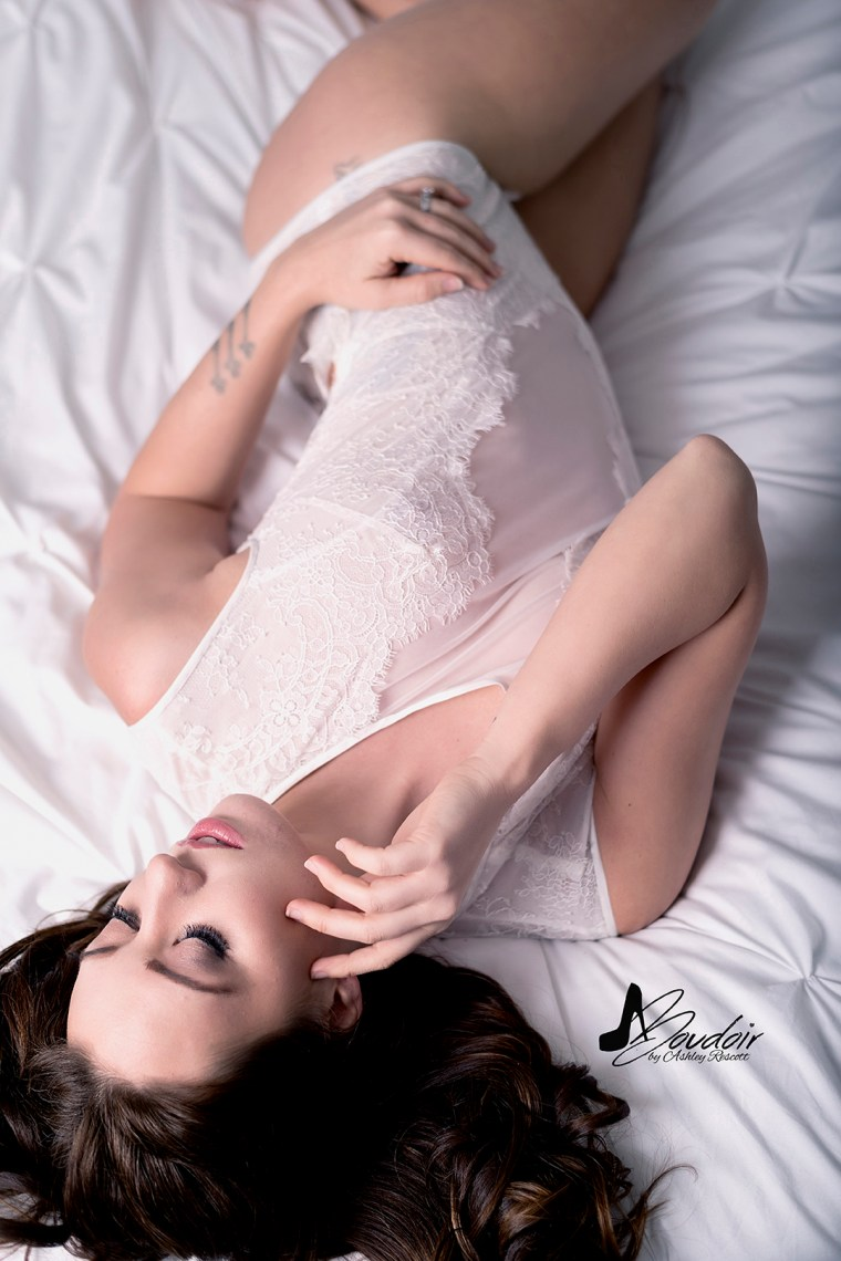 woman laying on bed in white lingerie