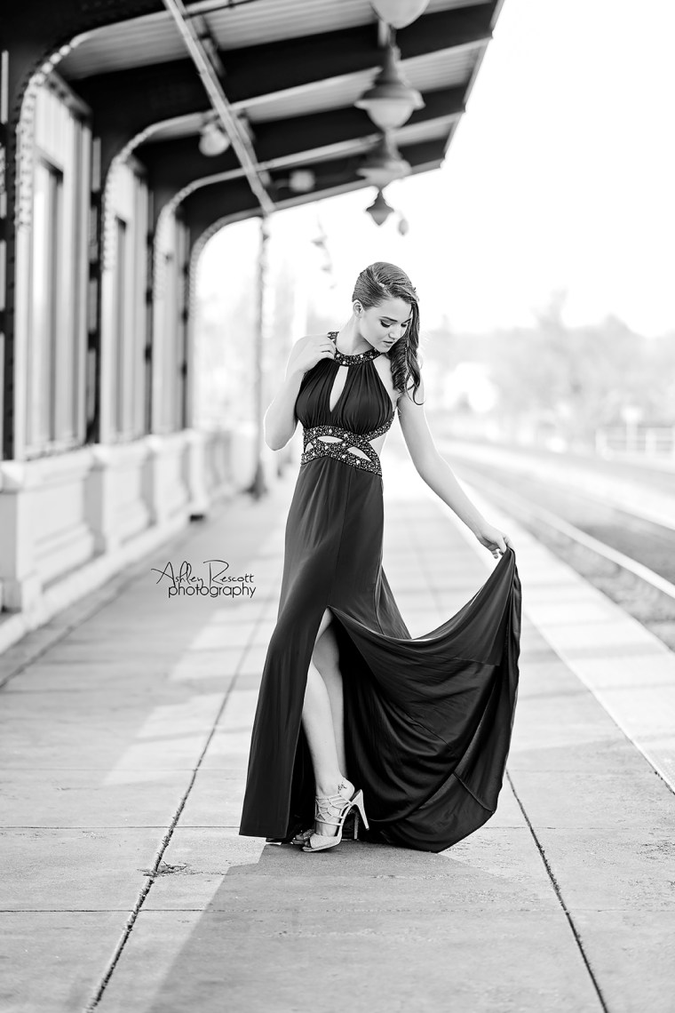 black and white image of high school senior girl in prom dress