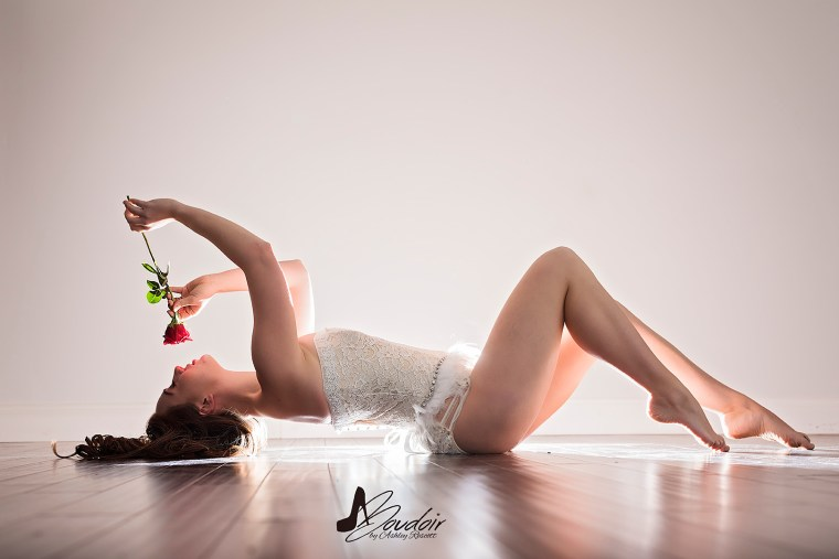 Woman in lingerie with red rose