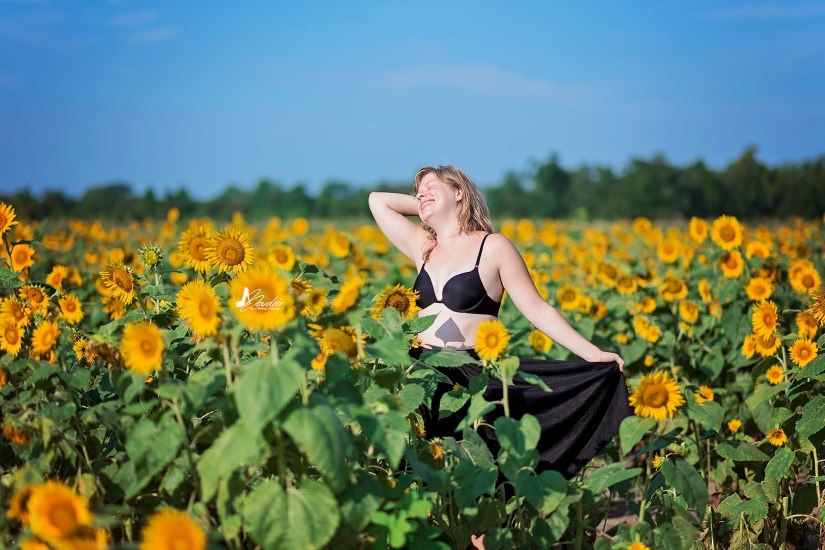 woman standing in sunflower field