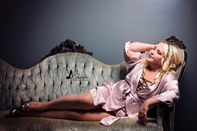 lady in pink silk robe on couch