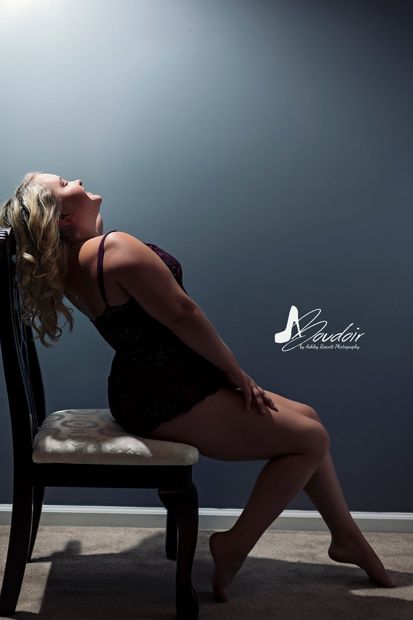 blonde bombshell on chair