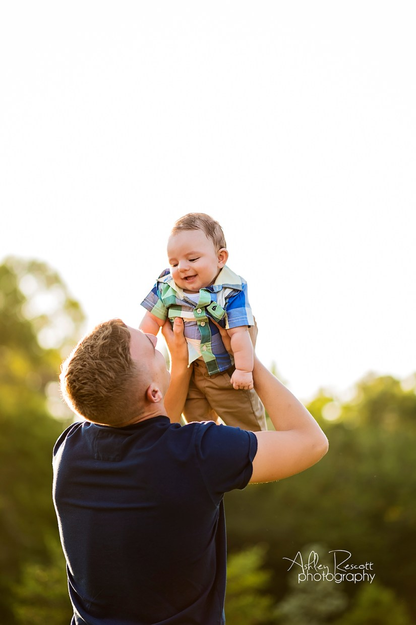 Daddy playing with baby son