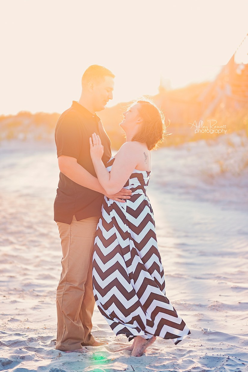 couple in front of sand dunes on beach
