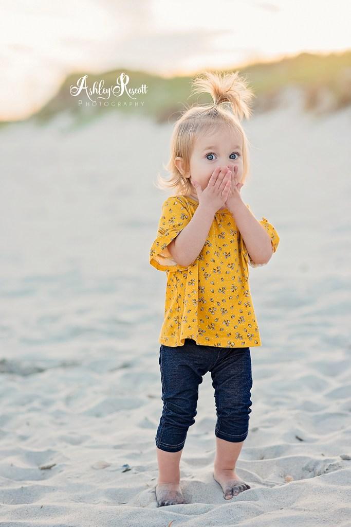 little girl on beach, surprised
