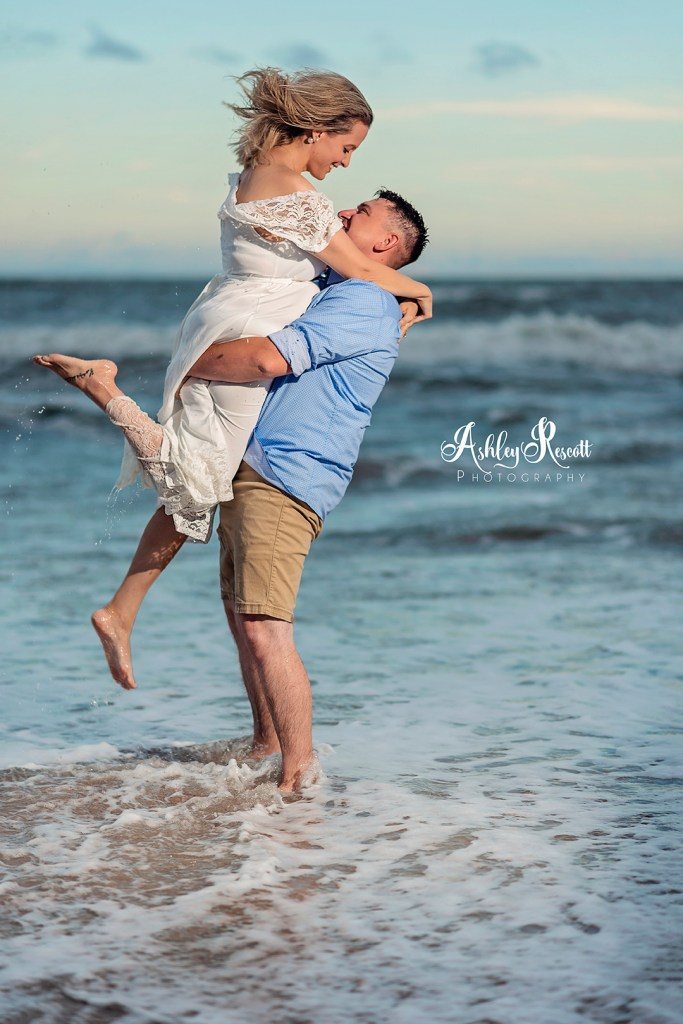 couple in water at beach