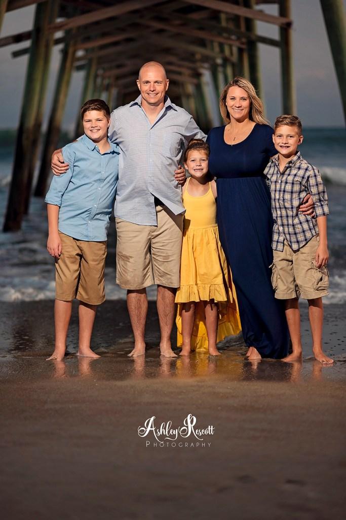 family under pier