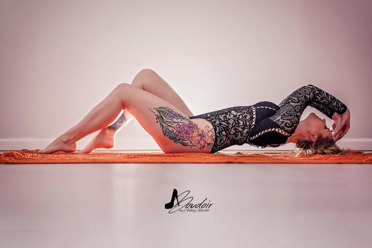 woman lying on orange blanket