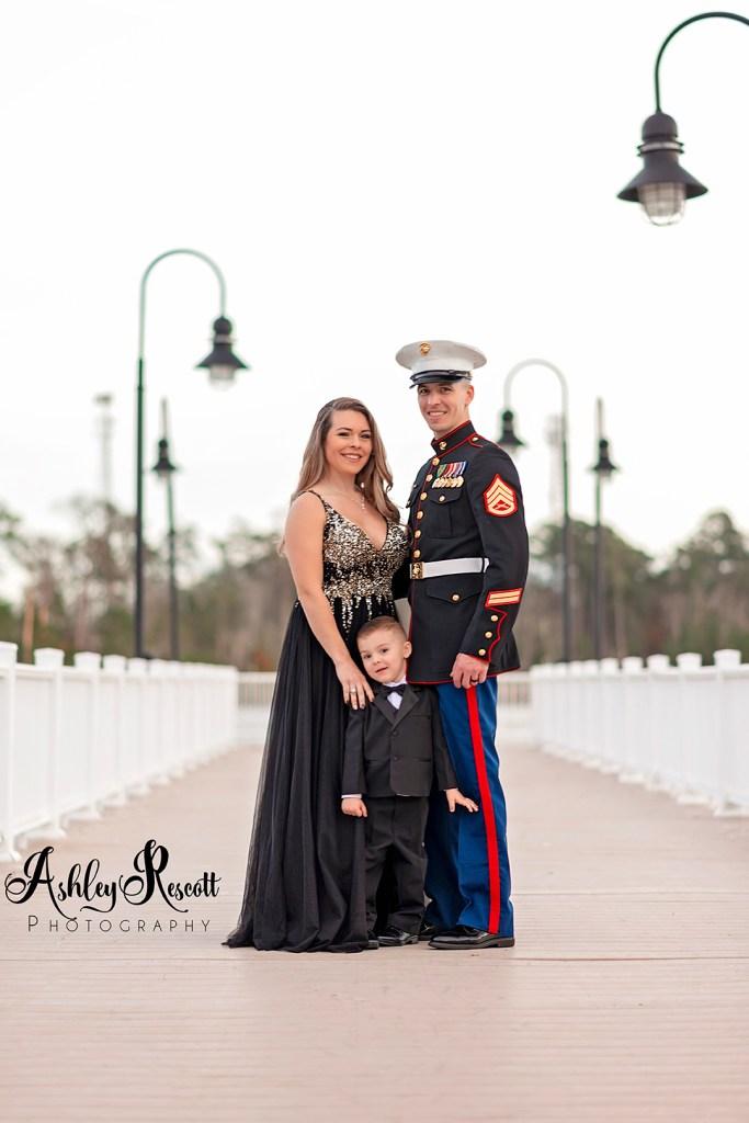 family in formalwear on pier