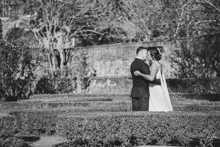 black & white image of bride & groom in the garden
