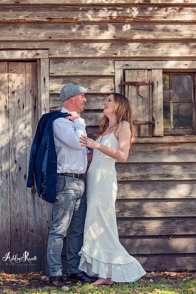 man and woman in front of cabin, engagement