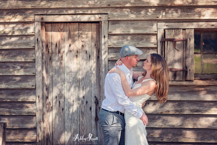 couple in front of cabin