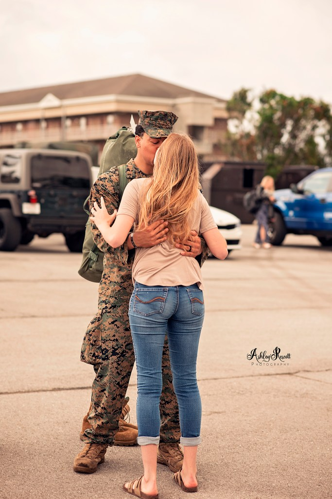 marine kissing his wife
