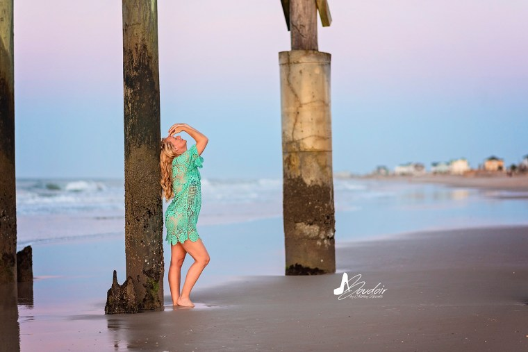 woman leaning against pier support