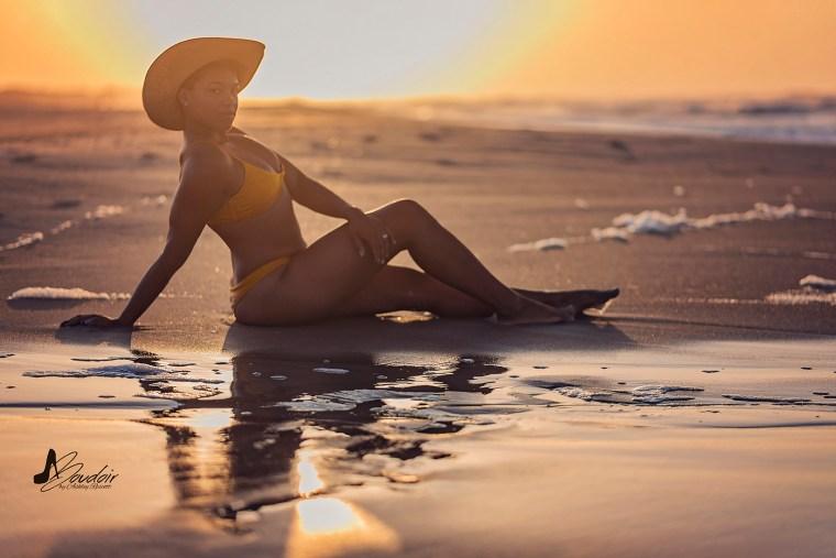 semi silhouette of woman sitting on beach