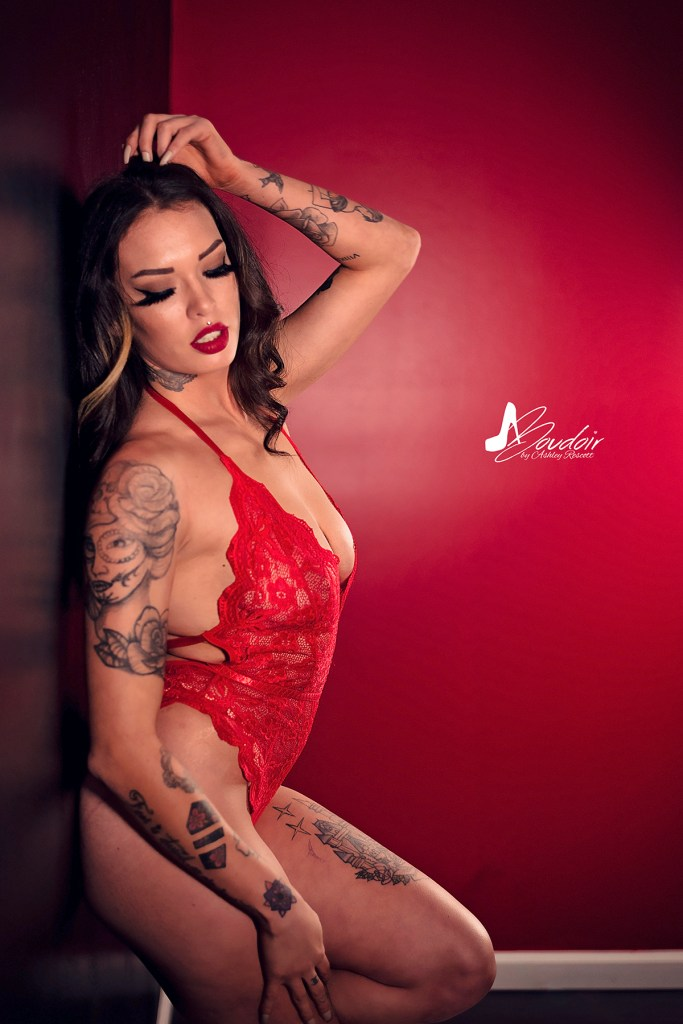 woman in red lingerie leaning against wall