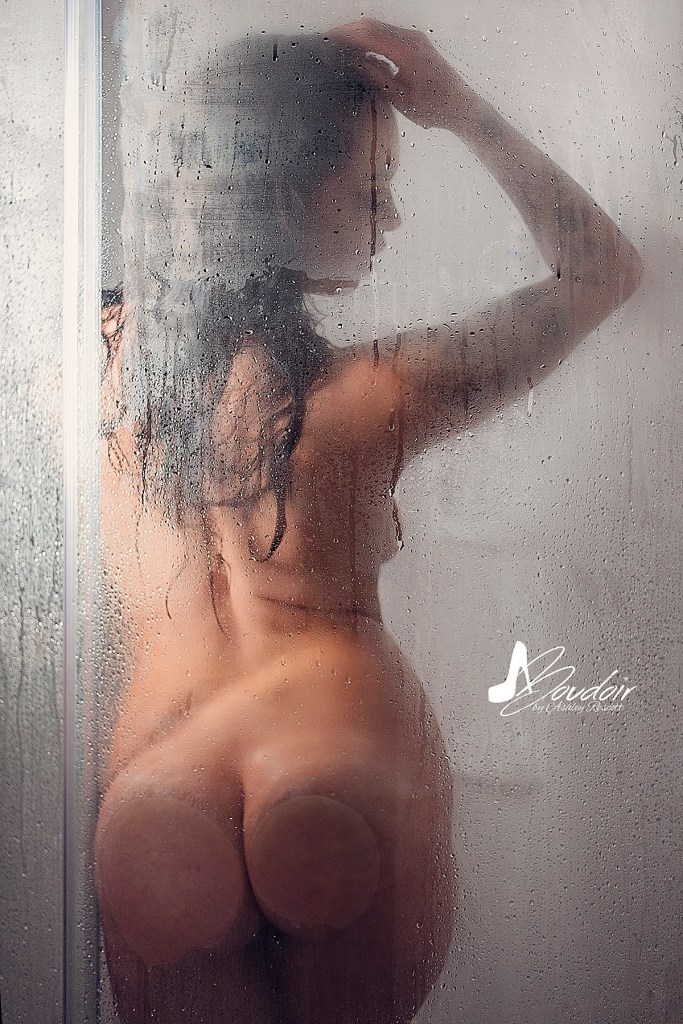 woman in shower, facing away