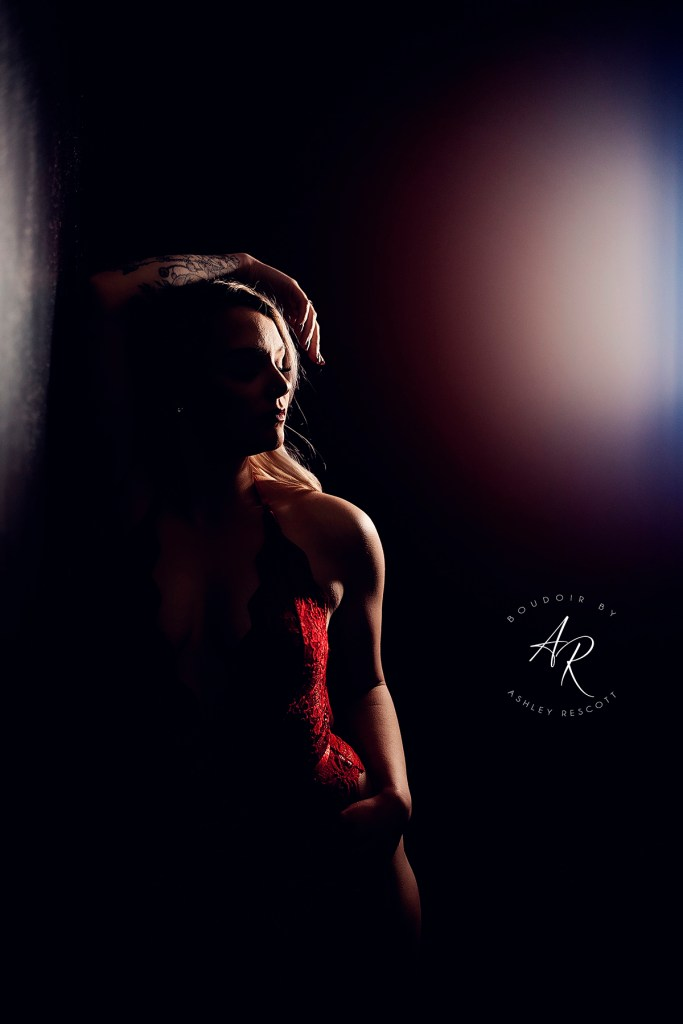 Portfolio image of the red room during a boudoir session