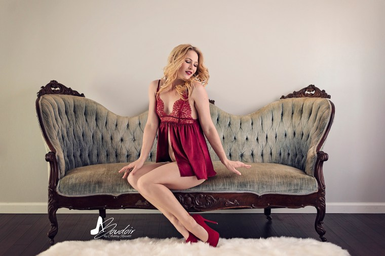 woman in red lingerie on blue couch