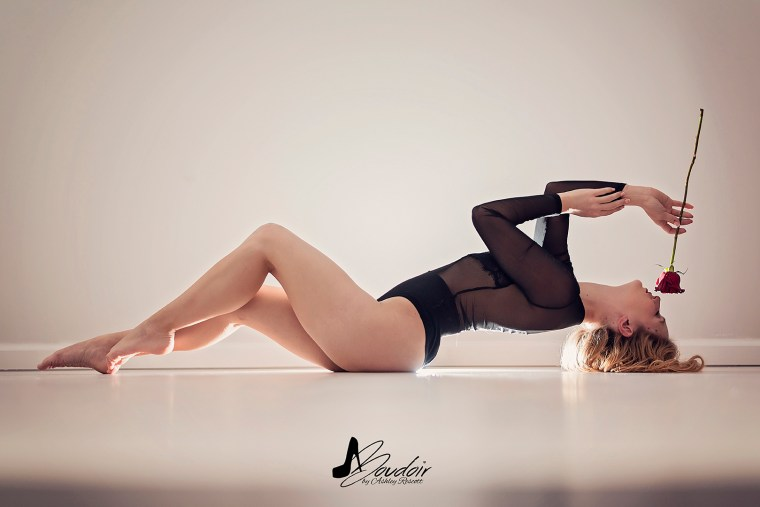 model lying on floor with rose