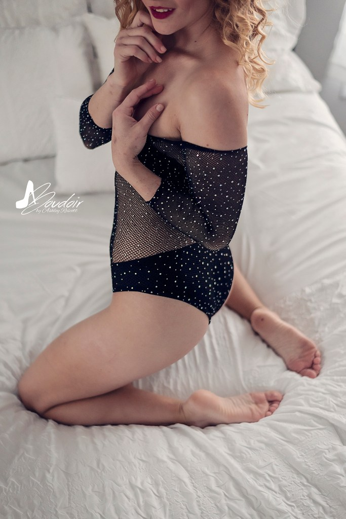 homey boudoir model kneeling on bed, anonymous