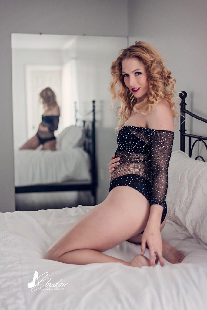 woman kneeling on bed in lingerie