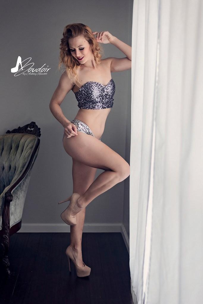 blonde woman standing by window in her underwear