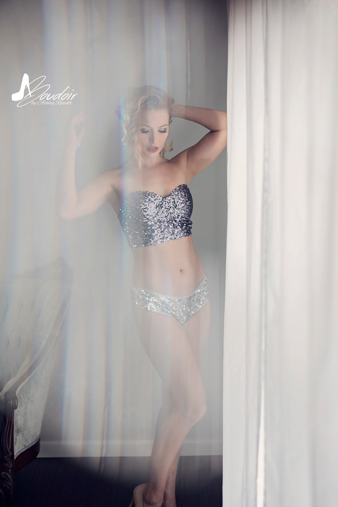 woman in sequin underwear by window
