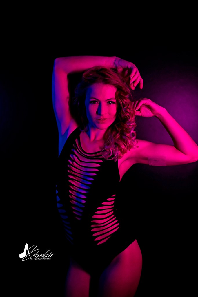 model in pink neon light